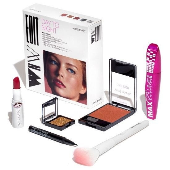 Makeup kit that includes brush, mascara, eyeliner, a brush, and more