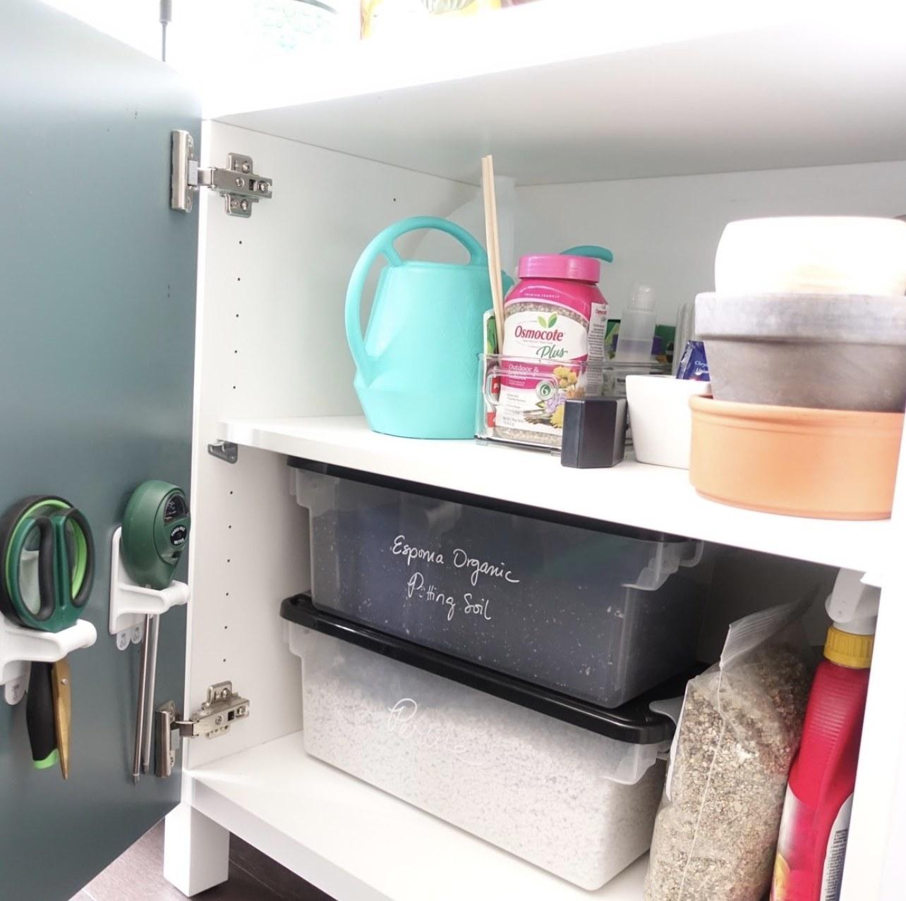 A cabinet of gardening supplies