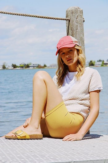 Model in yellow bike shorts
