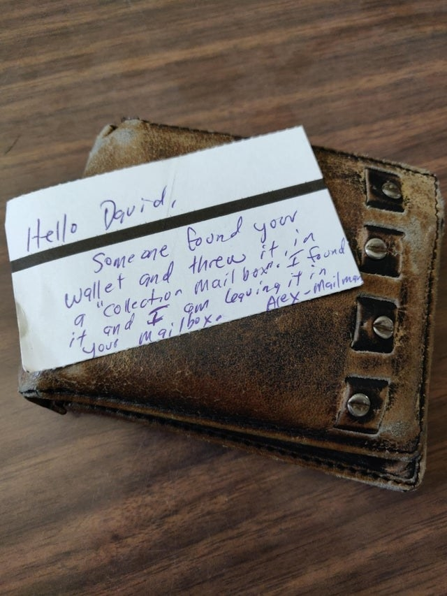 picture of a note from a mailperson about a found wallet