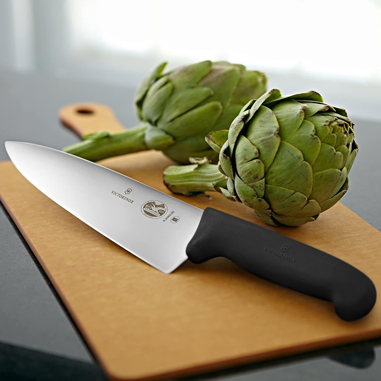 Chef's knife next to an artichoke