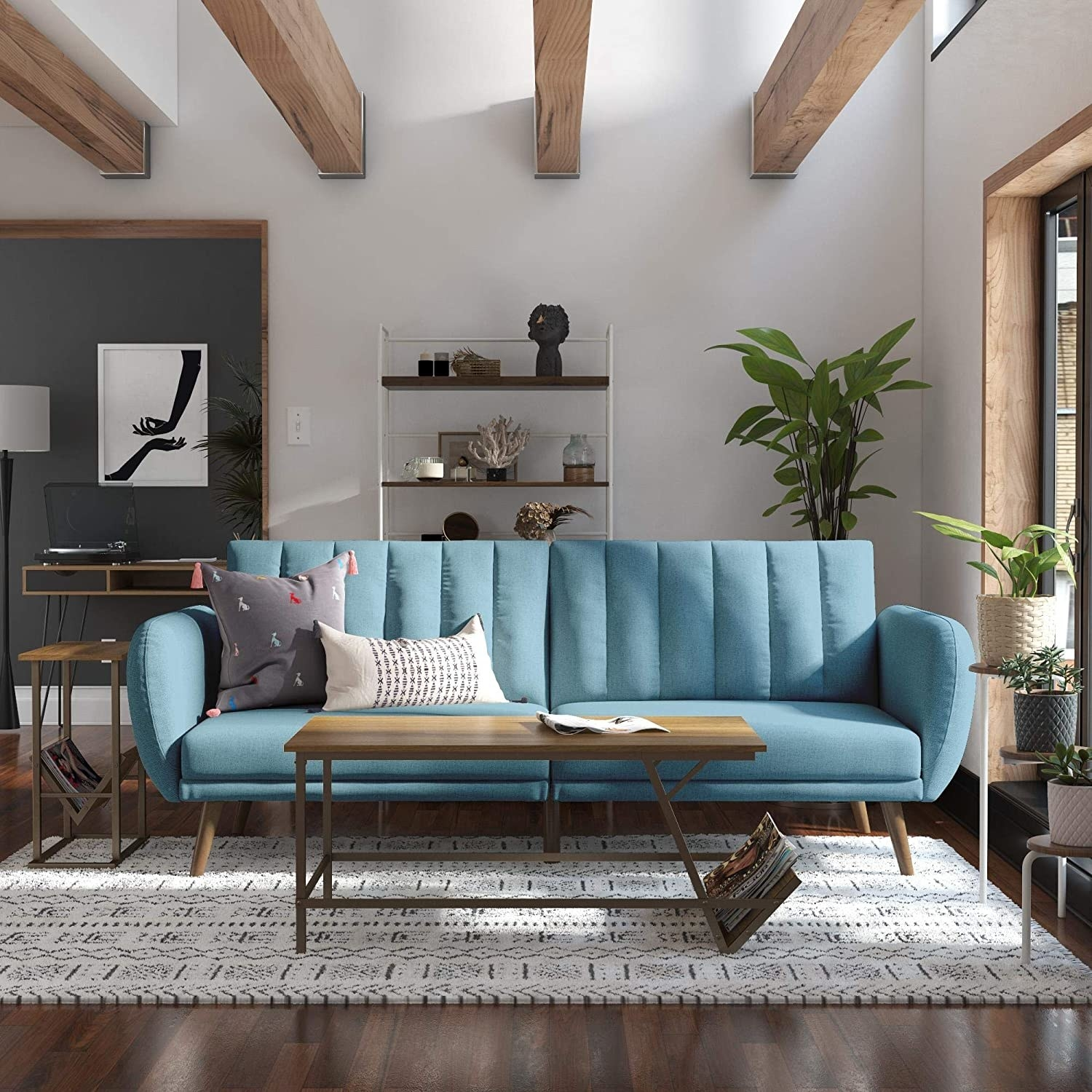 light blue vertically tufted couch