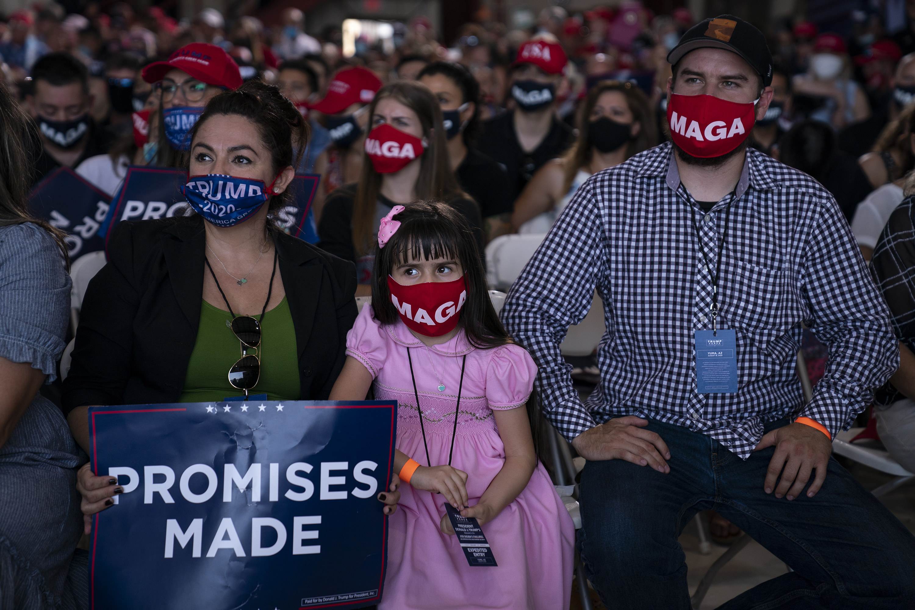 A crowd wearing MAGA masks