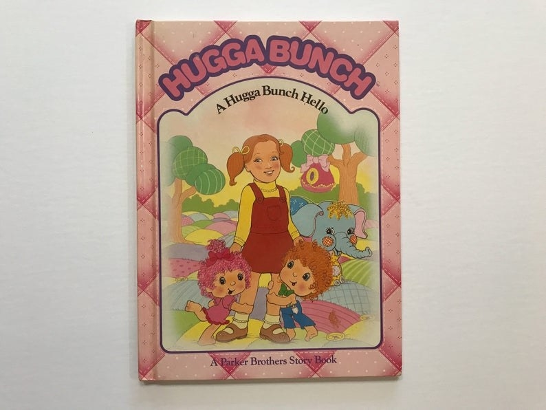 A Hugga Bunch book cover featuring two Hugga Bunch hugging the legs of a little girl.