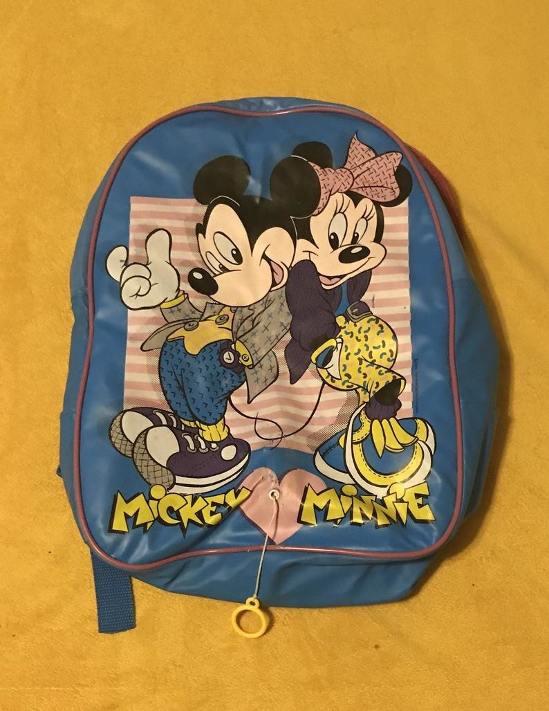 "A back backpack with Minnie and Mickey dressed in late '80s ""hip clothes"""