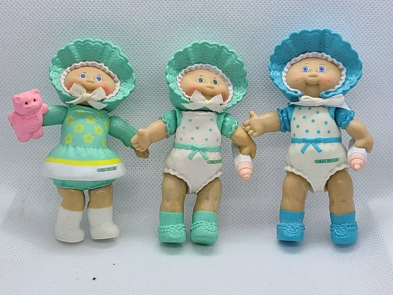 Three Cabbage Patch Kids posable PVC figures.