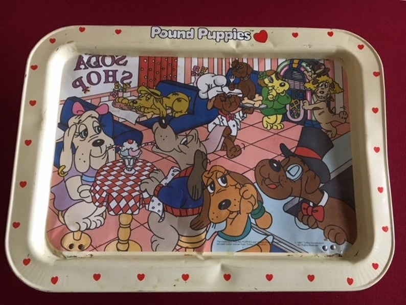 A metal pound puppies TV tray.