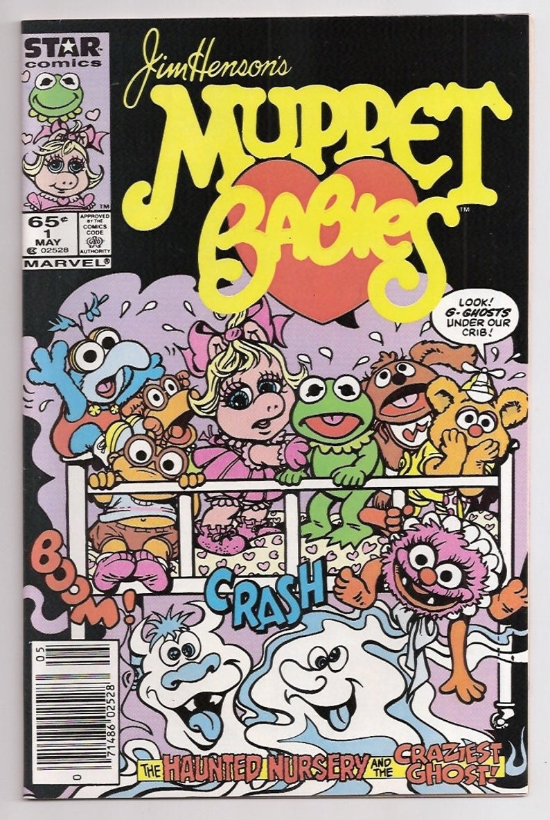 A Muppet Babies comic, which features the characters looking scared in their crib with ghosts underneath it.