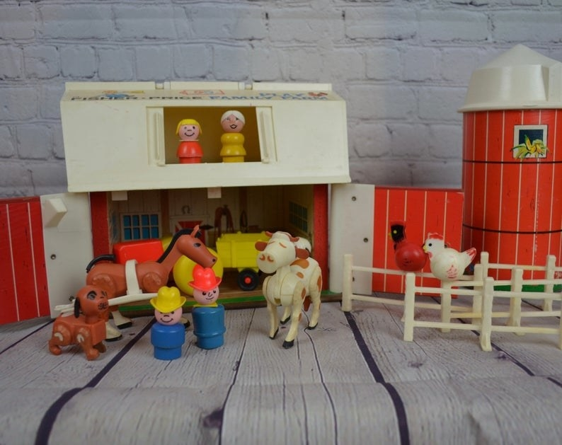 A Fisher-Price Family Farm set up with all the parts.