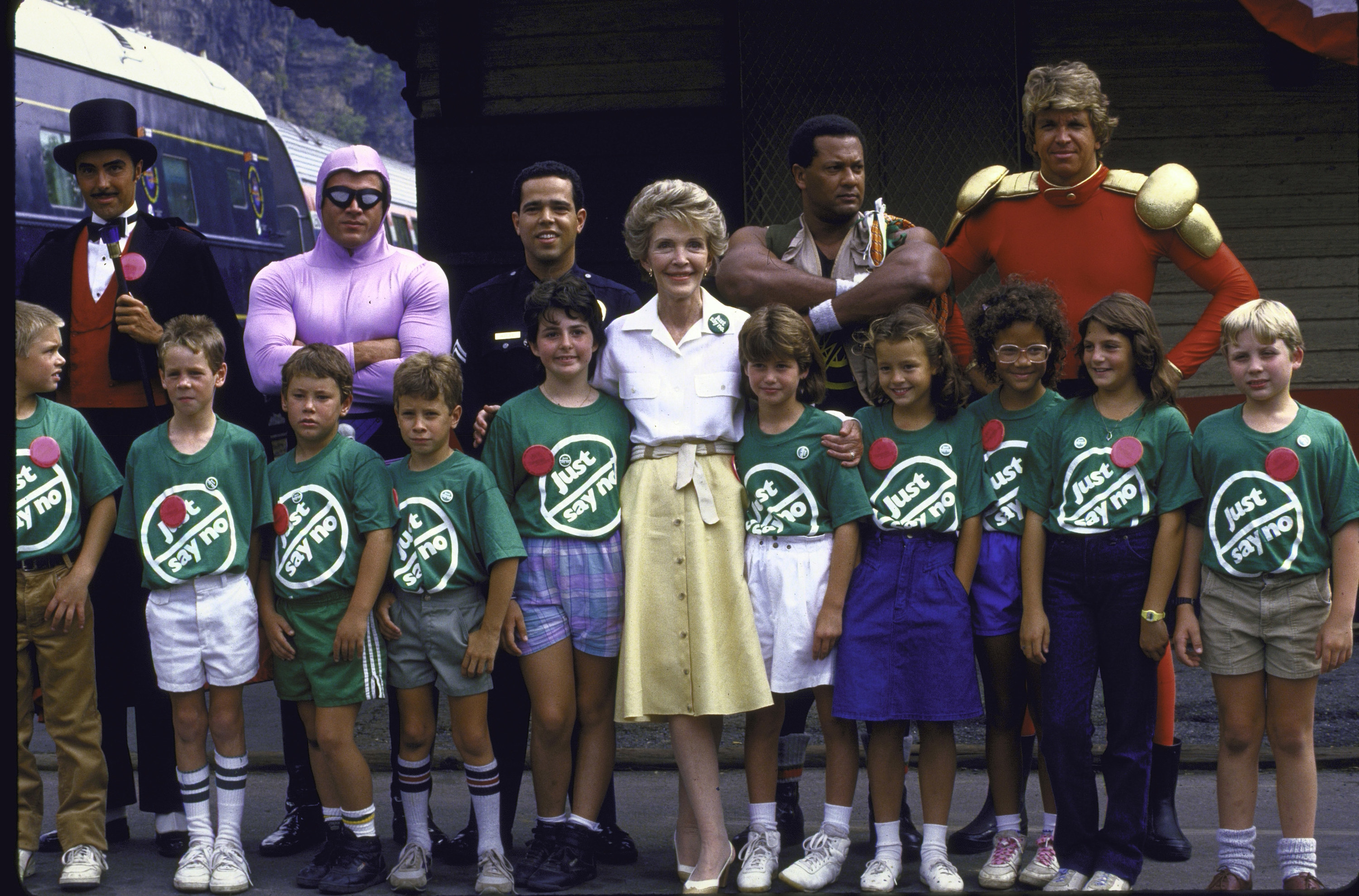 "Nancy Regan in the middle of a dozen children wearing green ""Just Say No"" T-shirts."