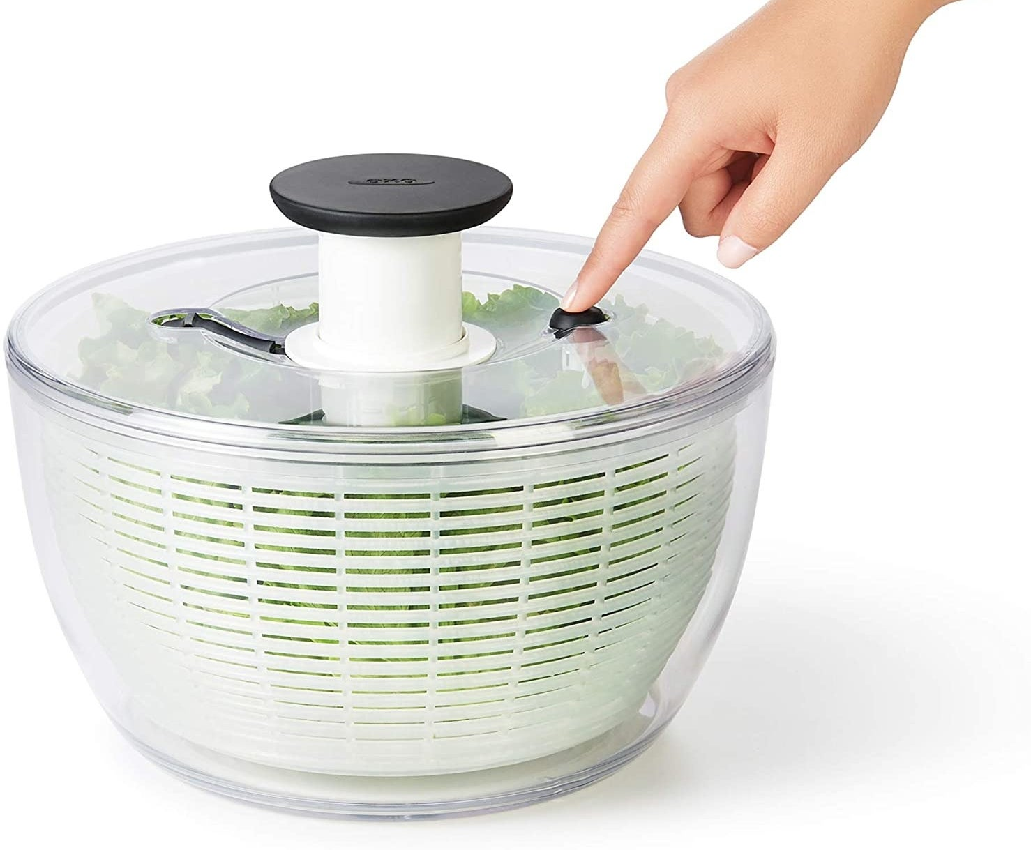 Salad spinner being pressed