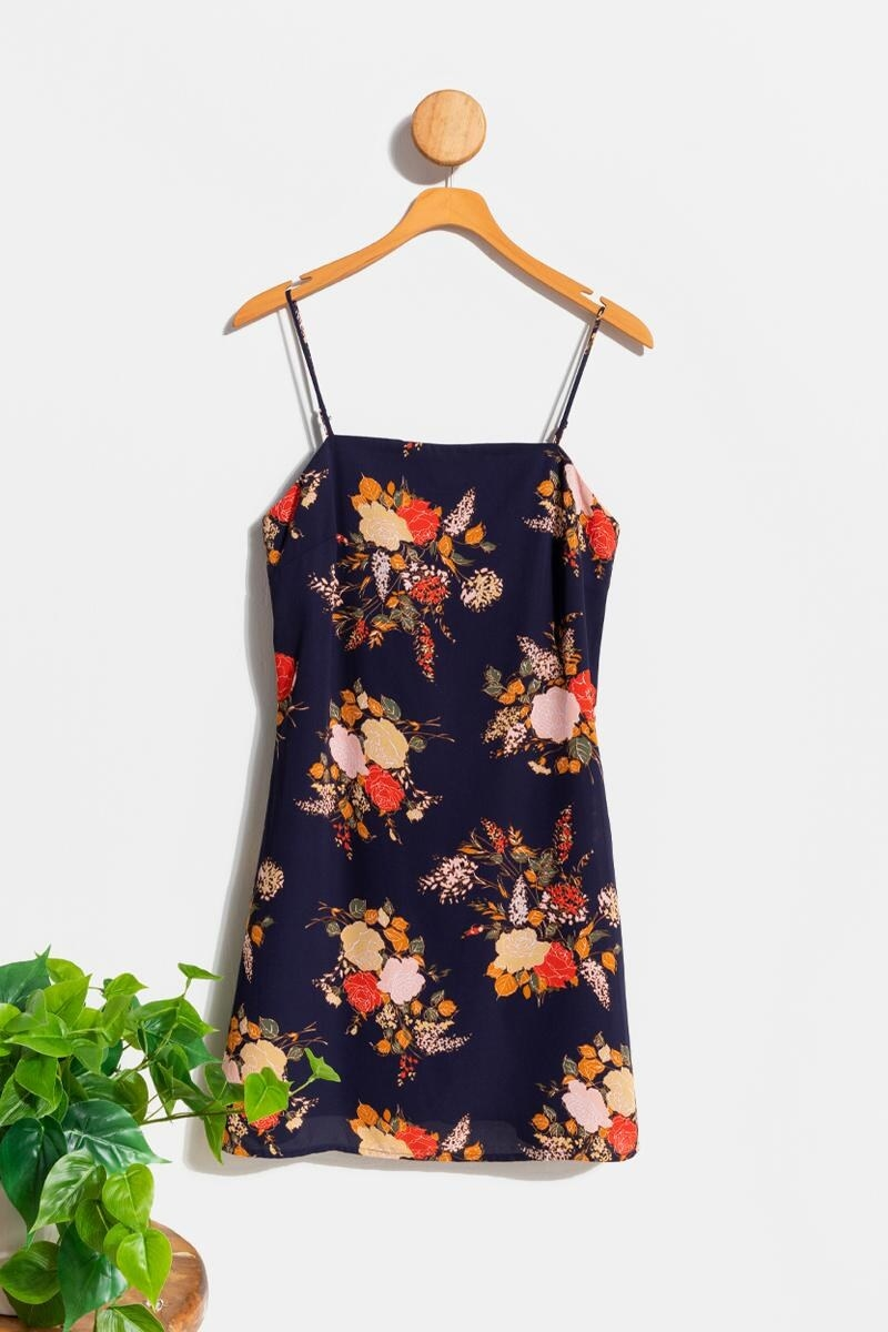 a navy mini dress with fall colored florals on it