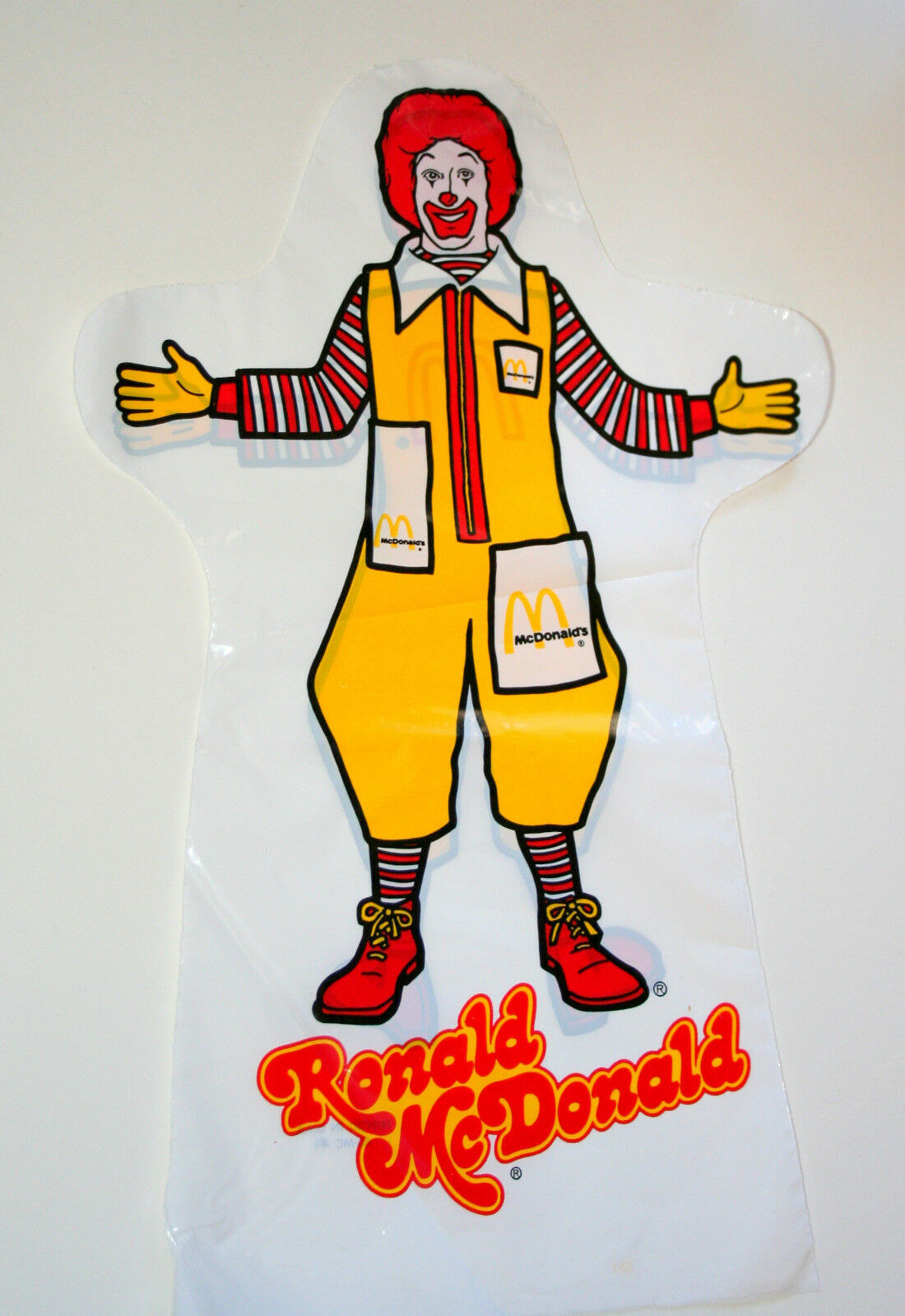 A plastic bag in the shape of puppet with Ronald McDonald on it.