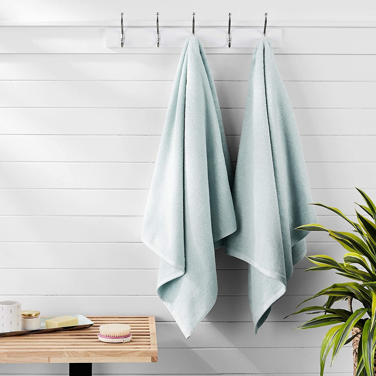 Pastel blue towels hanging on wall