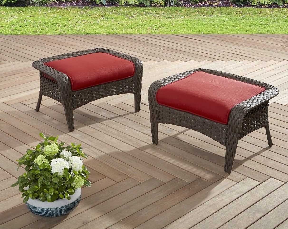 two red ottomans outside