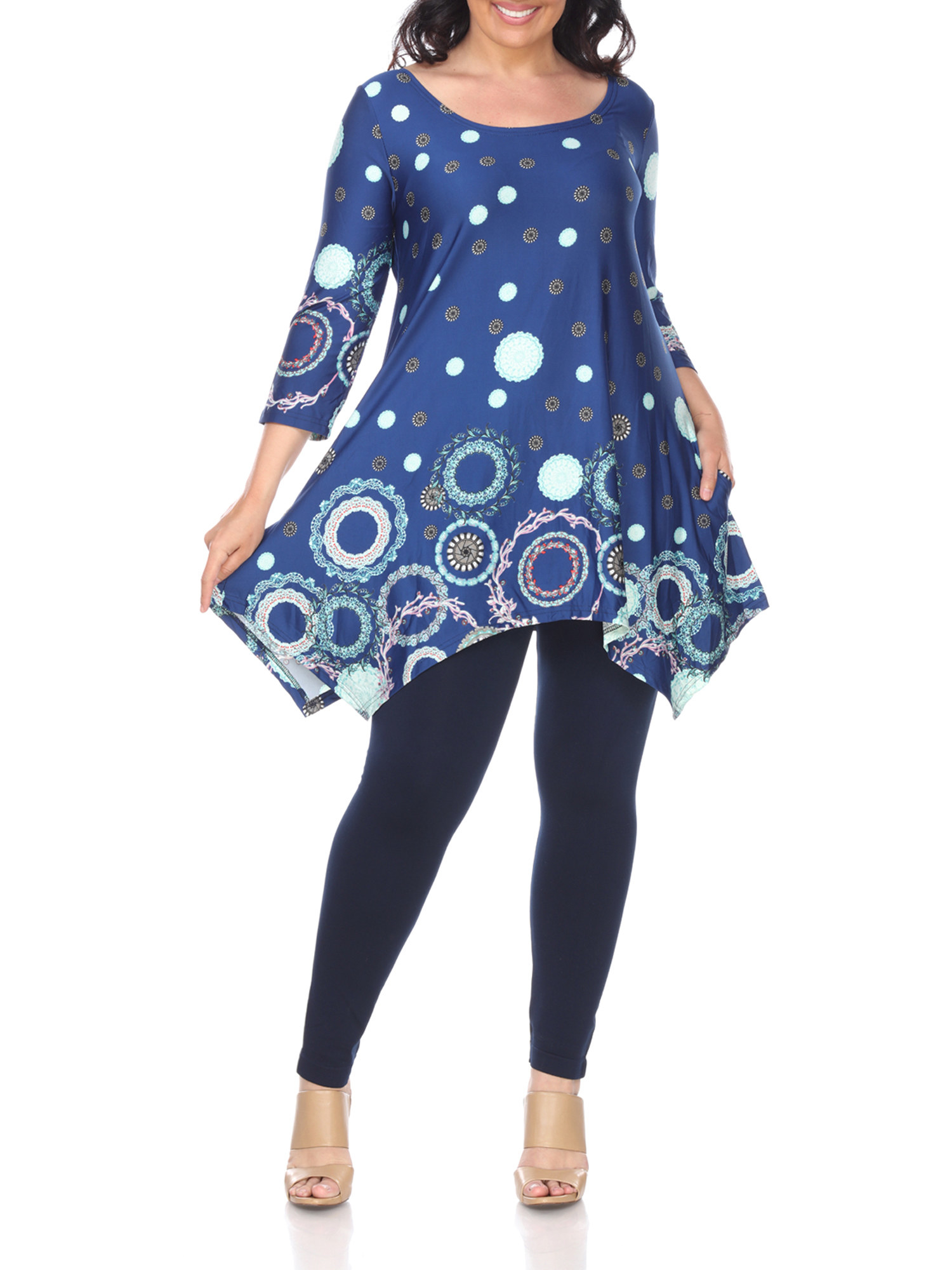 Model wearing blue patterned tunic with asymmetric hem