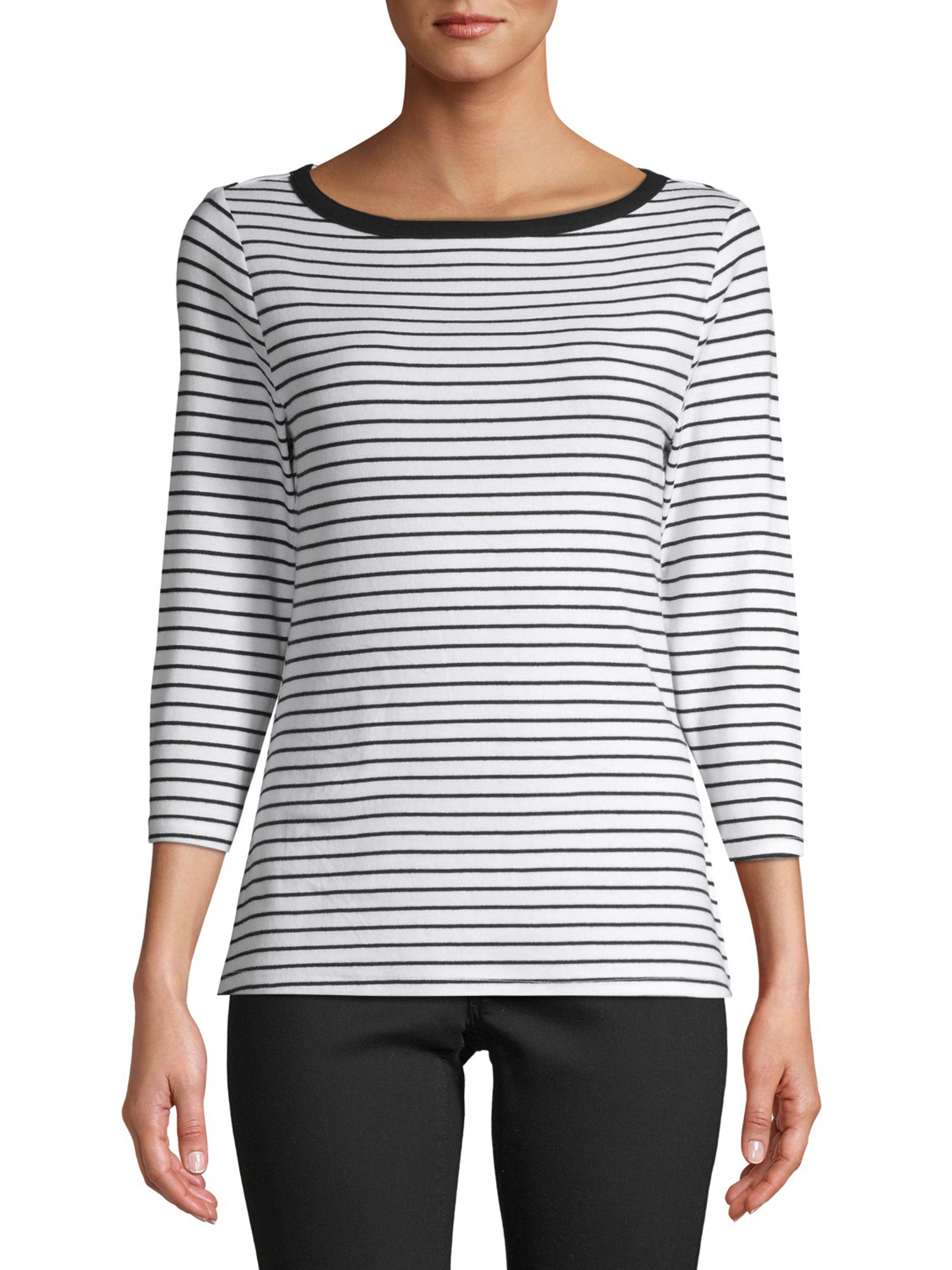 Model wearing black and white striped sleeved top