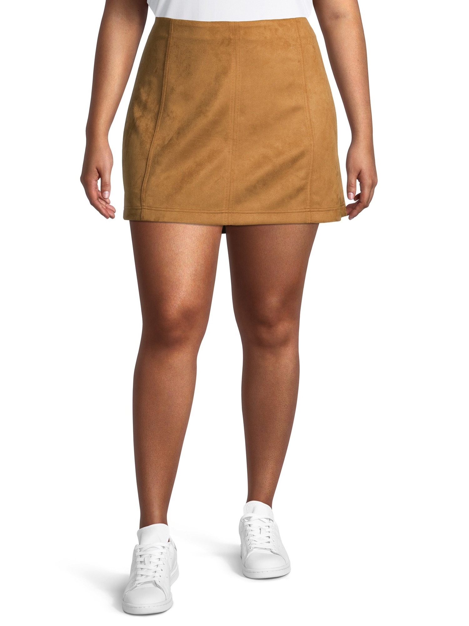 Model wearing tan mini skirt.