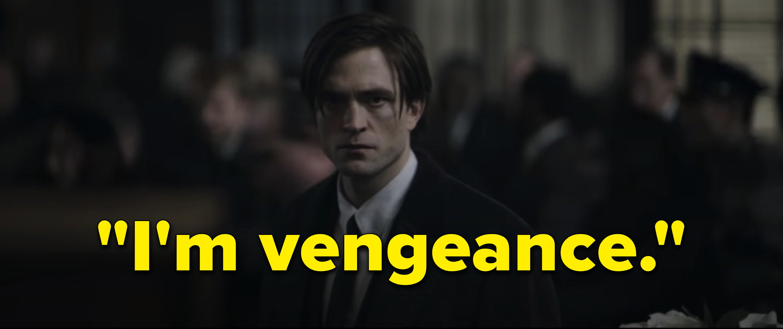 Robert Pattinson as Bruce Wayne in a suit