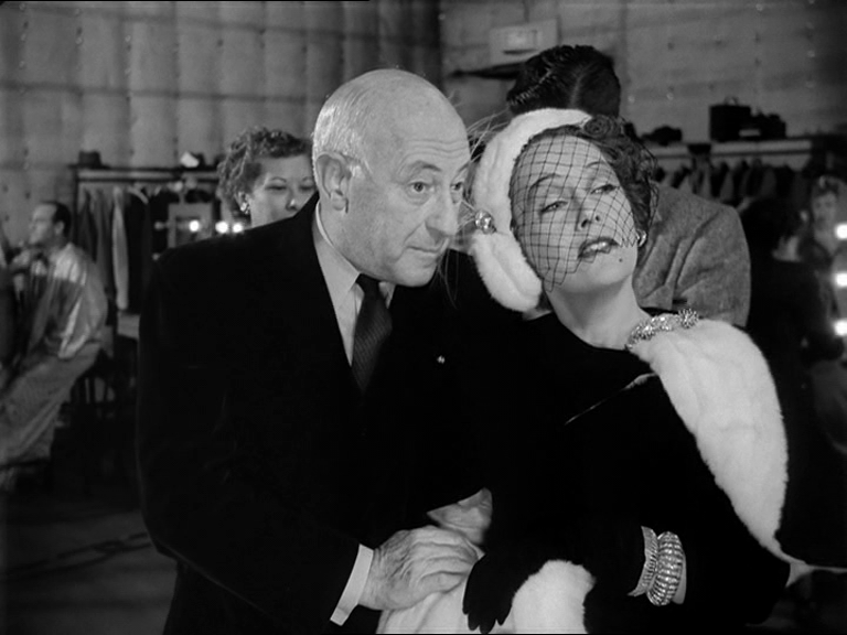 Cecil B. DeMille, playing himself with Norma Desmond, played by Gloria Swanson in Sunset Boulevard (film)