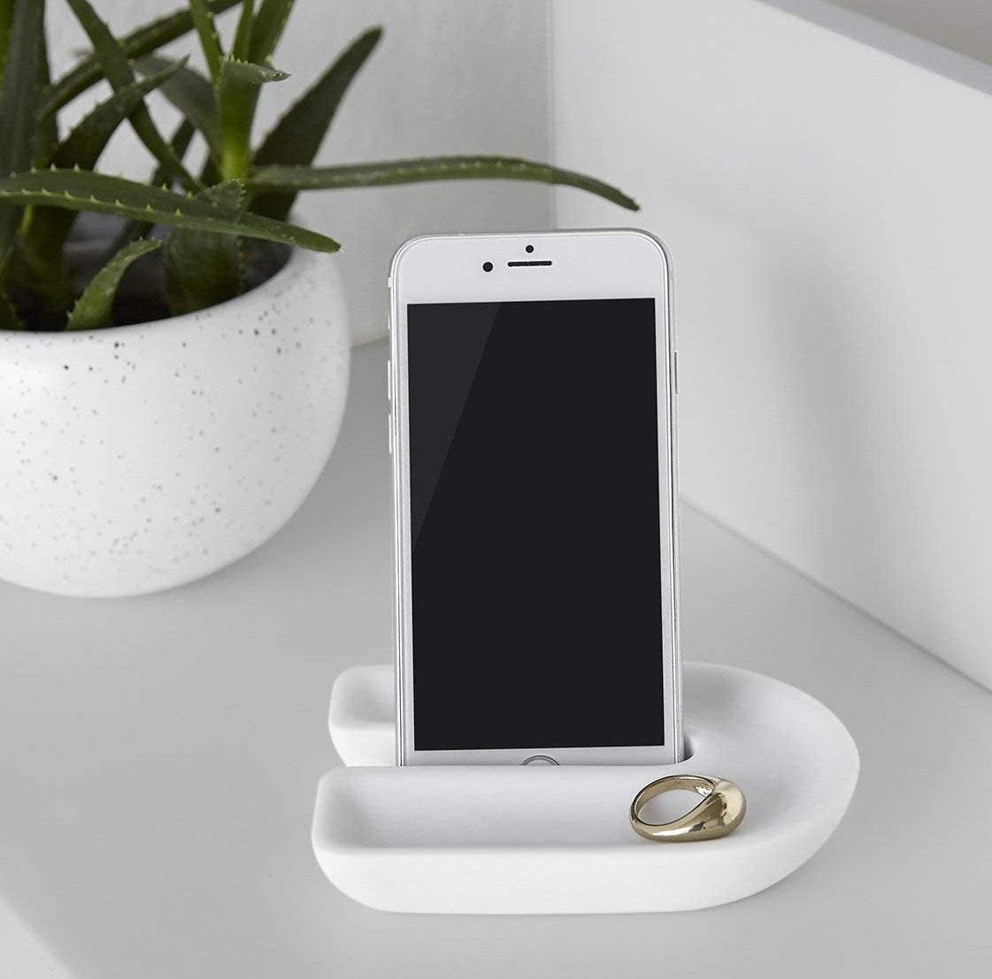 the white countertop tray with an iPhone and ring inside