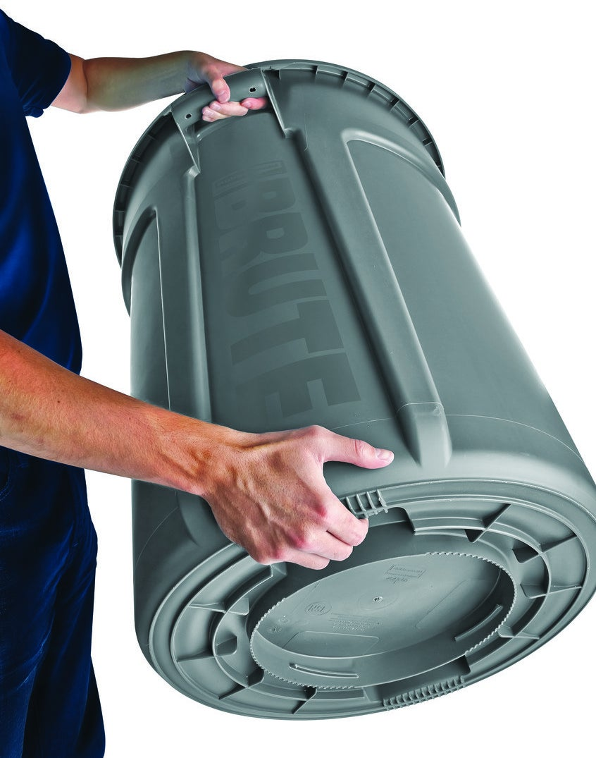 Model holding a large greenish gray garbage container