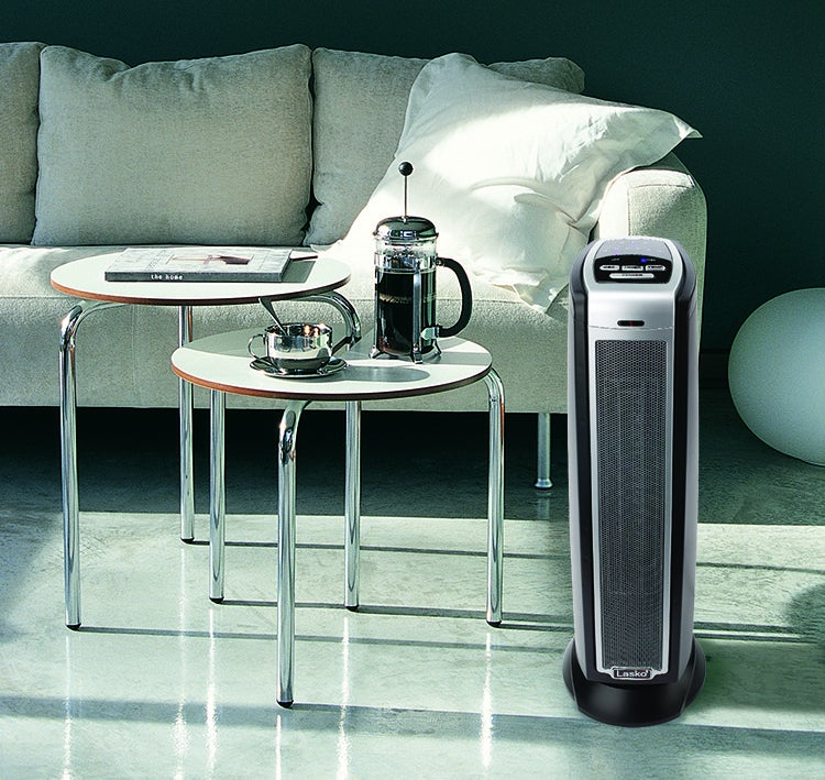 Gray, black, and silver tower heater