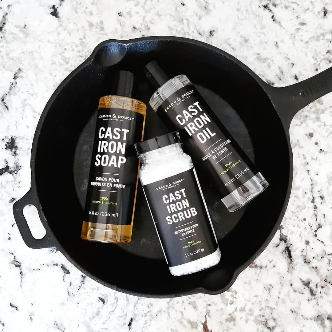 A flatlay of the cast iron cleaning set inside a large clean cast iron pan