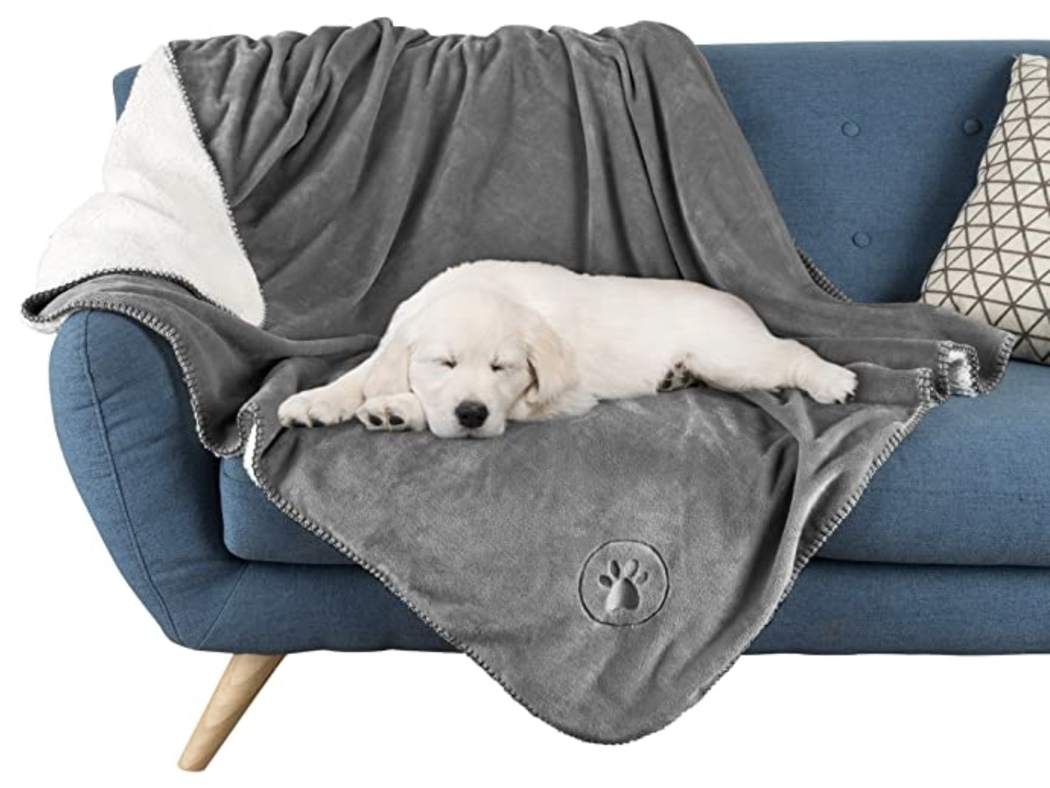 A yellow lab puppy sleeping on a grey waterproof pet blanket