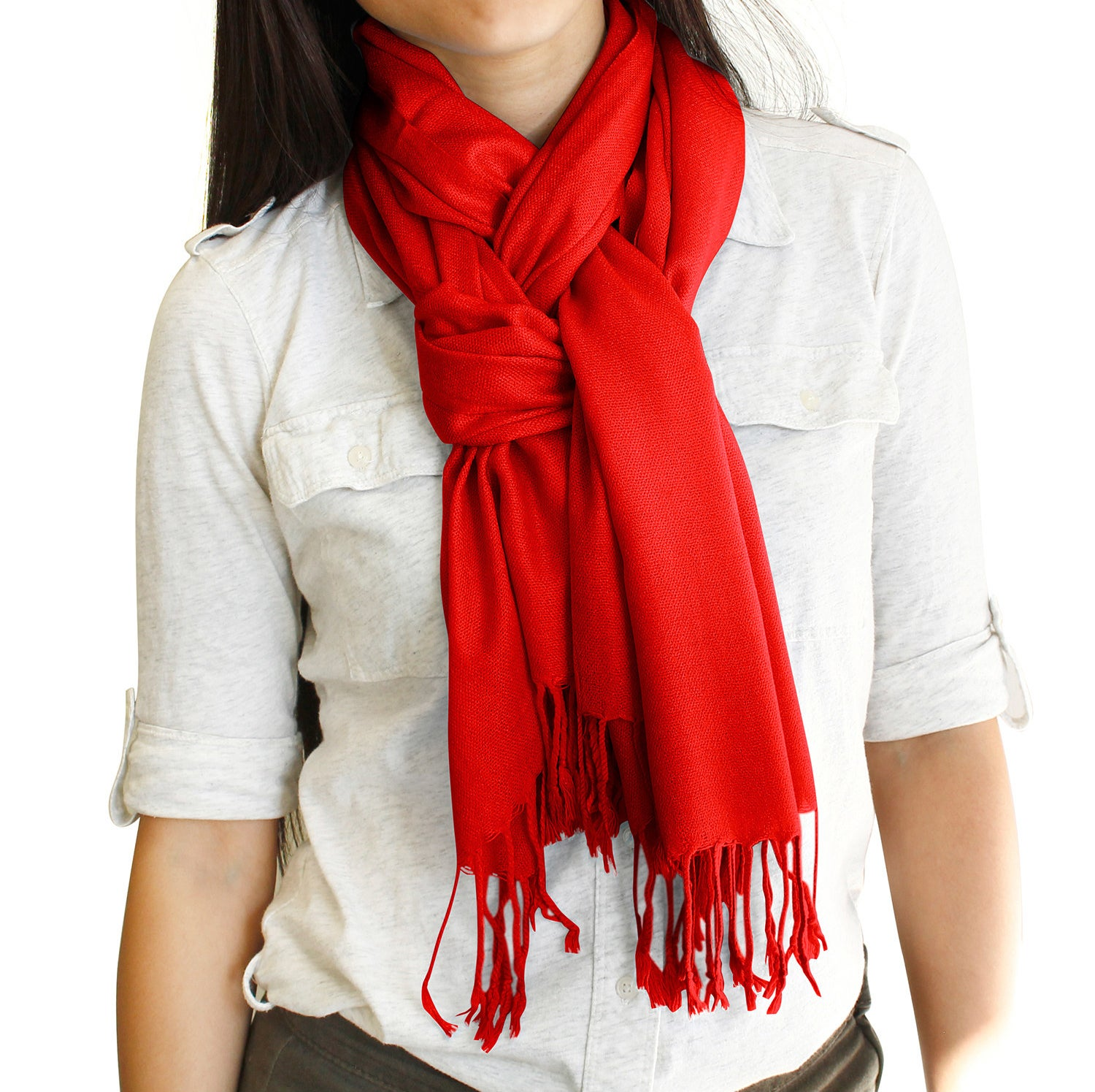 Model wearing a bright red scarf