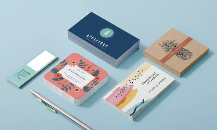 Five sets of business cards in various shapes and sizes