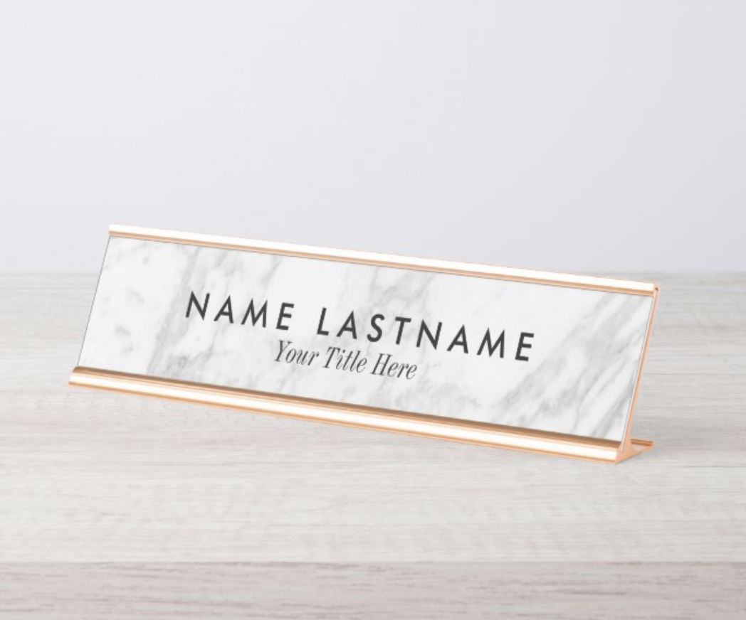Marble print name plate with space for a first and last name and job title