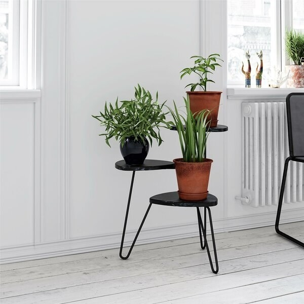 Three tiered black plant stand with connected, rounded wire legs