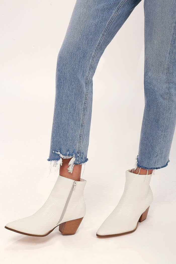 Lulus X Matisse white ankle booties with a snake print texture and pointed toe