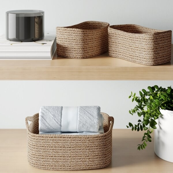 Three nesting baskets with handles made of tan corded fabric