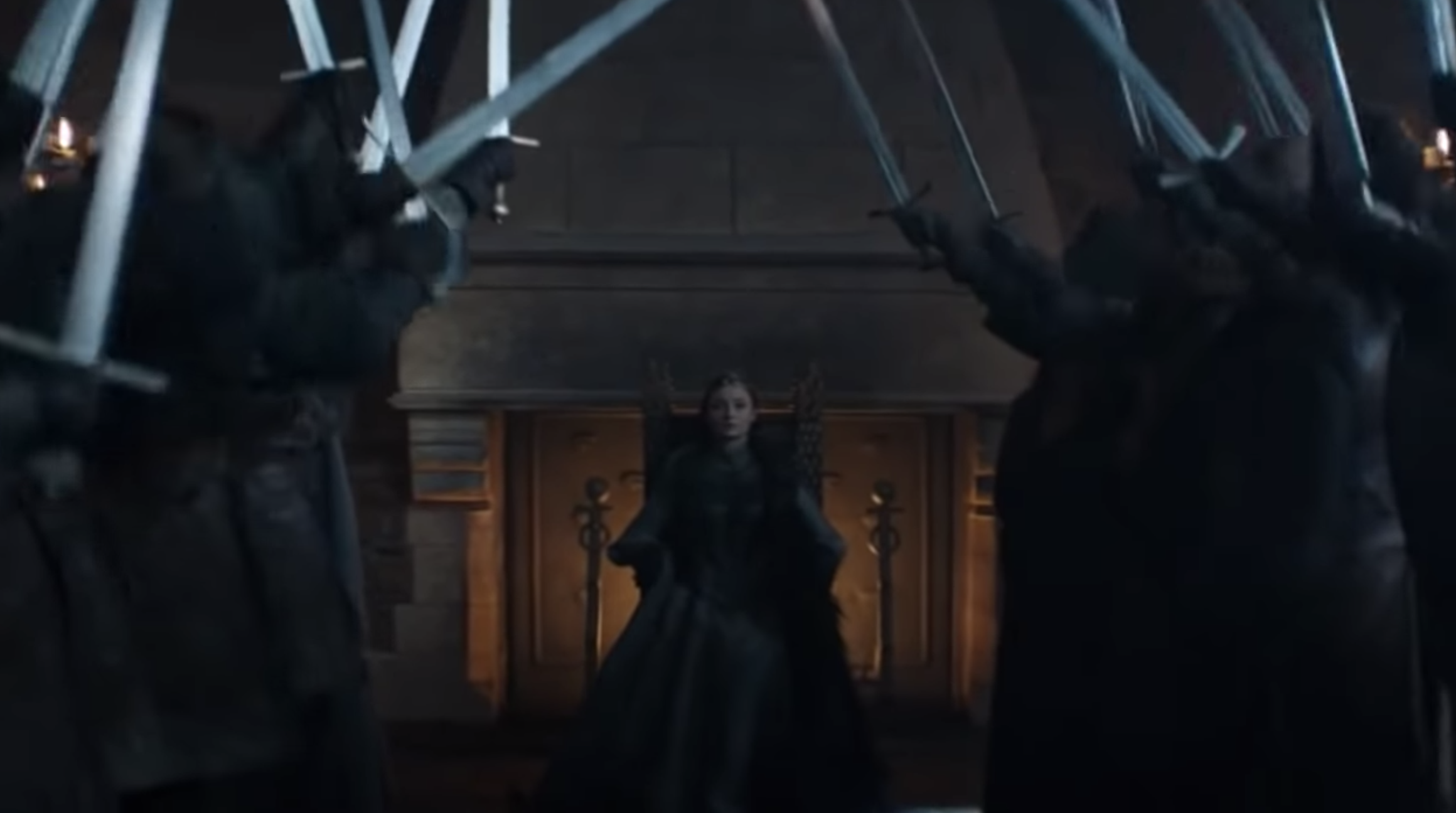 """Sansa sitting on the throne as people lift their swords in to say, """"The Queen of the North!"""""""