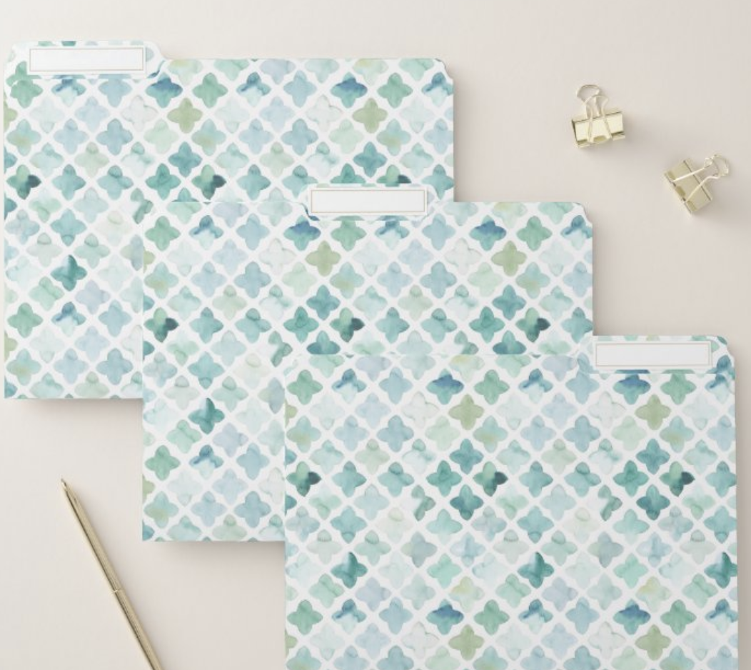 Three patterned blue and green file folders