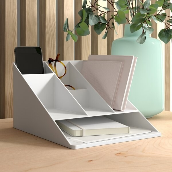 White desk organizer with plastic cell phone sleeve and four storage spaces