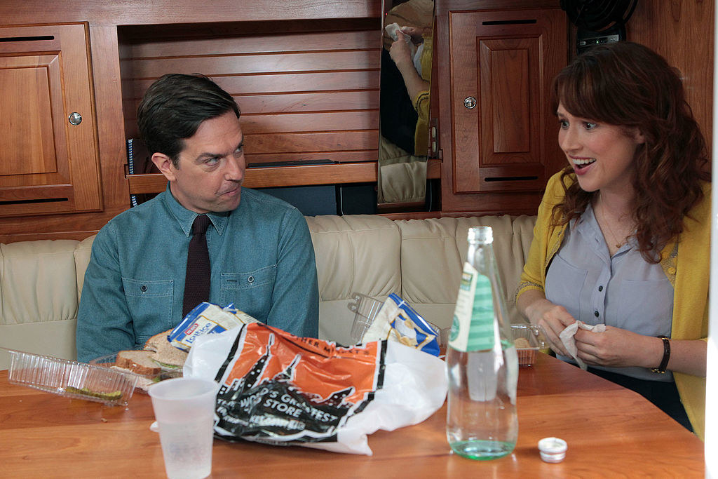 """Ed Helms and Ellie Kemper in character on """"The Office"""""""