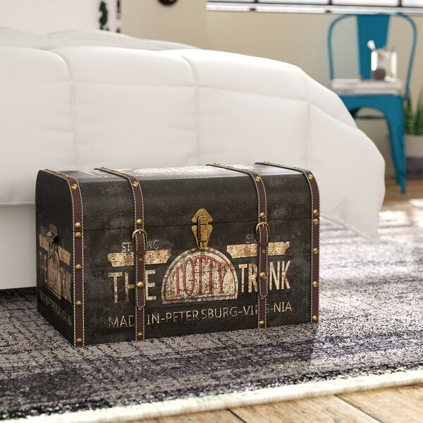 Vintage style trunk with gold buckles and faded graphics