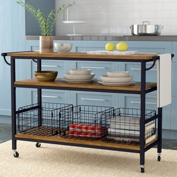 Long three shelf kitchen island with wheels and included wire baskets
