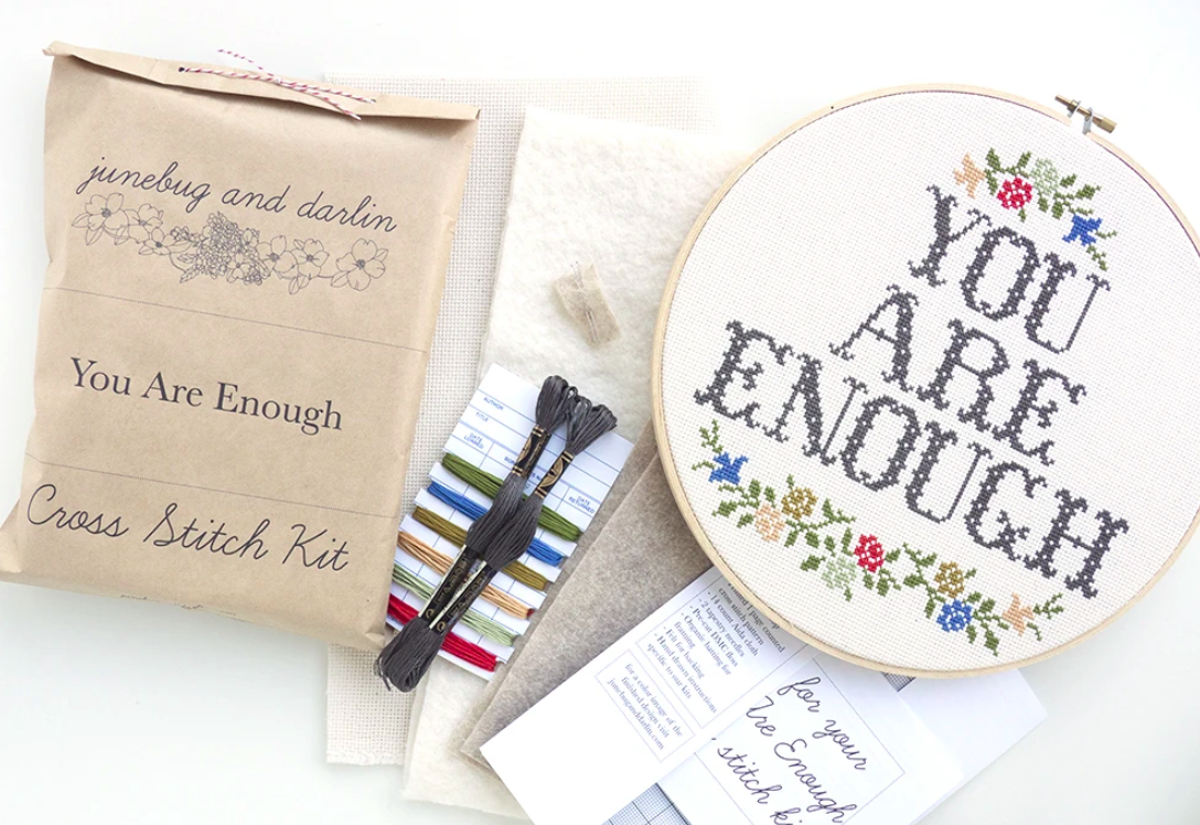 "A cross-stitch kit with the text ""you are enough"" on it"