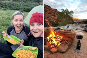 two women eating mac and cheese from plastic plates; campfire burning at a campsite in a park