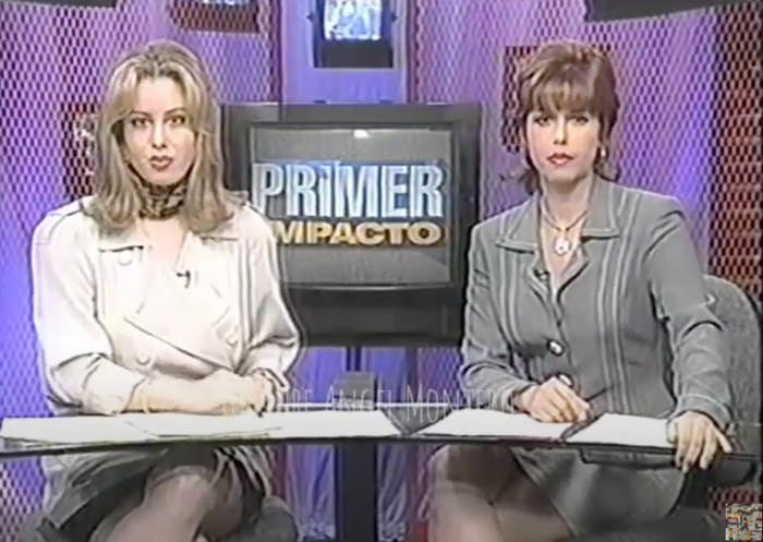 Two hosts sitting at the desk of Primer Impacto