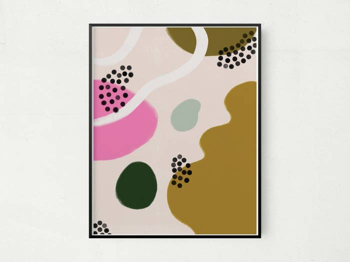 Rectangle print with an abstract print of pink, green, blue, and yellow blobs, black dot blobs, and a white line blob