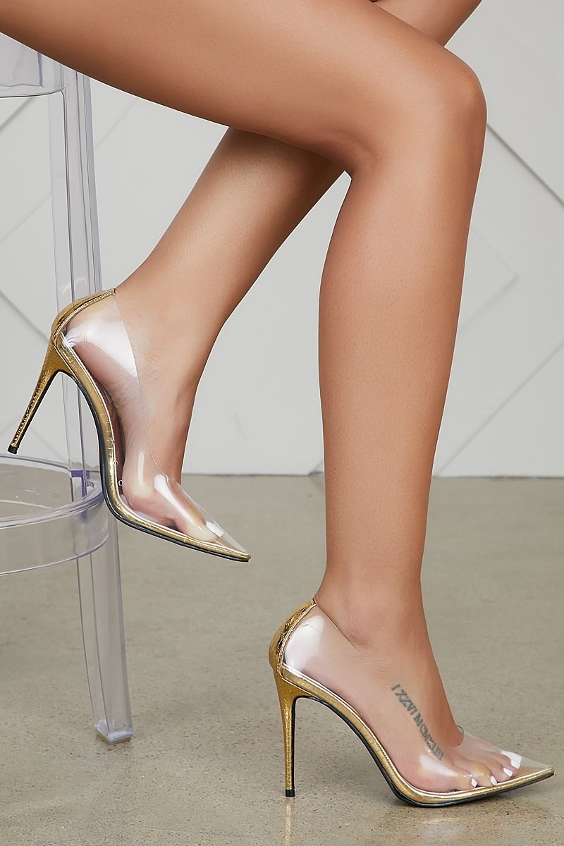 Lilly's Kloset transparent heels with a gole sole and heel