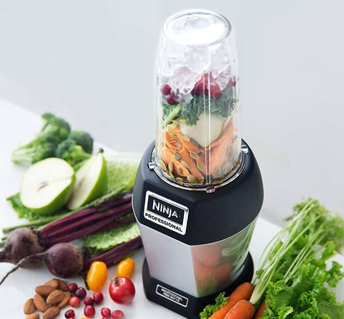 The Ninja blender filled with fruits and veggies