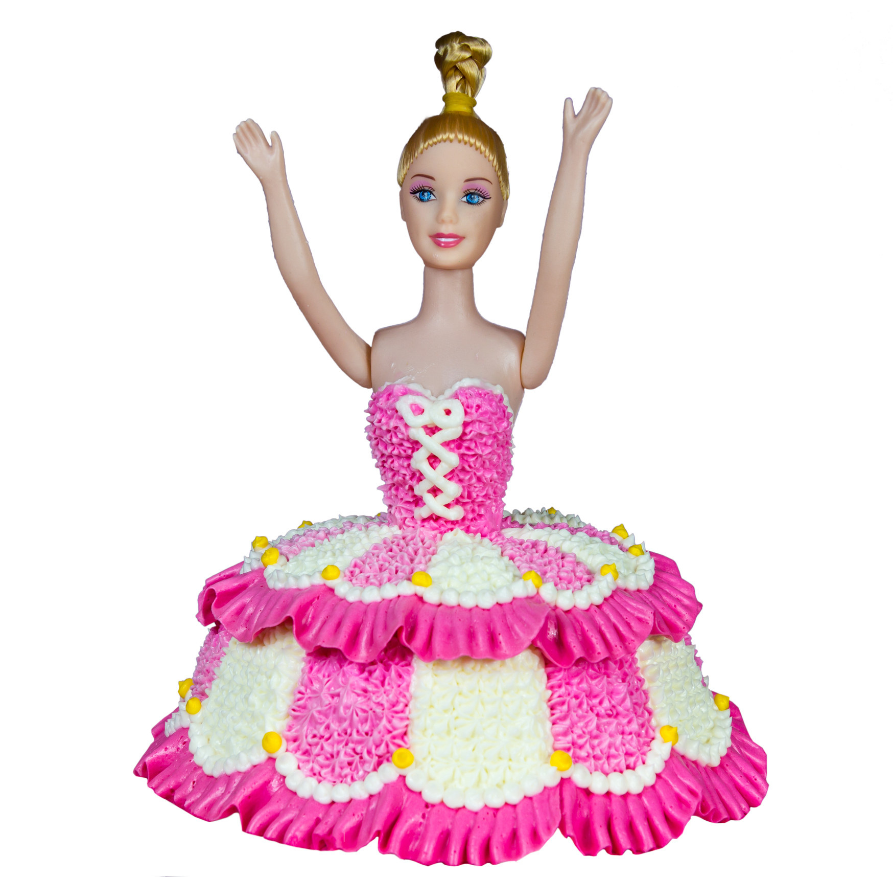 A photo of a Barbie-esque doll with a pink and cream-colored dress made of frosting