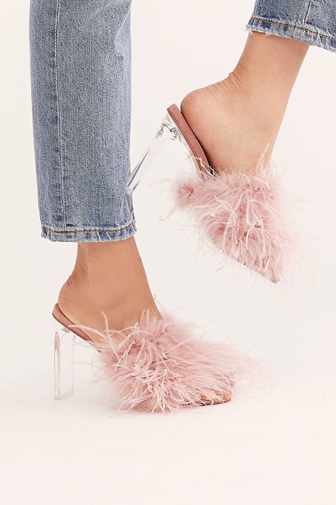 Jeffrey Campbell daisy shoe with pink feathery straps and a lucite heel