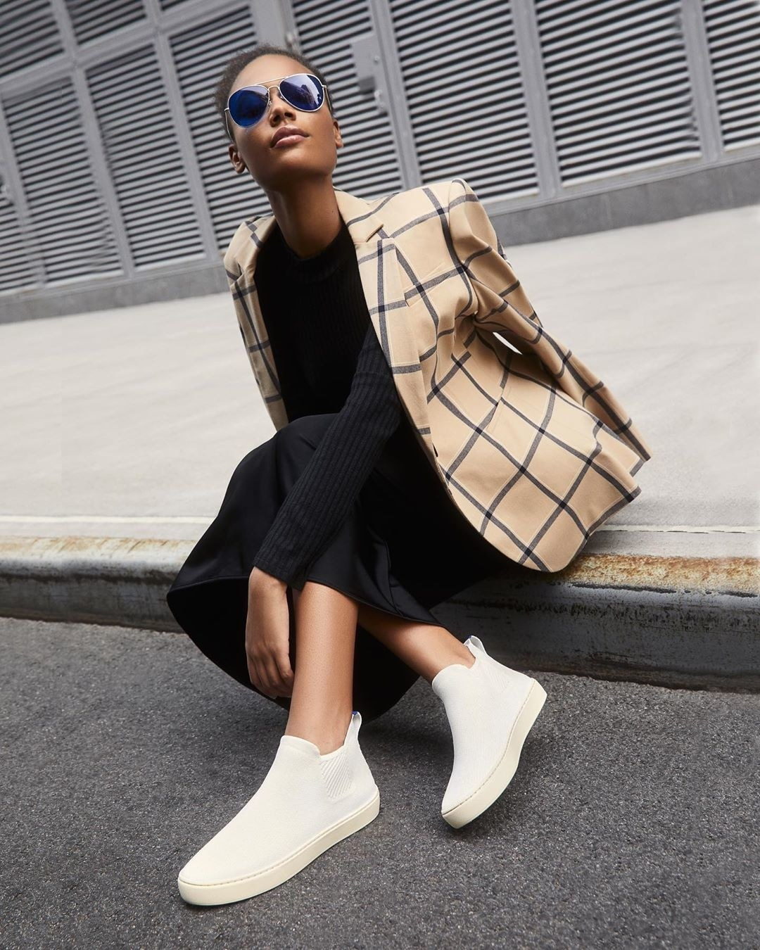 Model wearing Rothy Chelsea boot in white